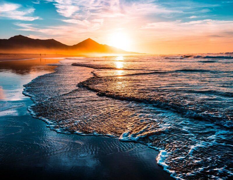 beach mountains sunset