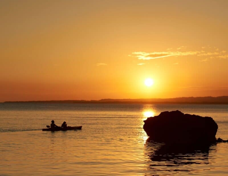 couple in boat at sunset