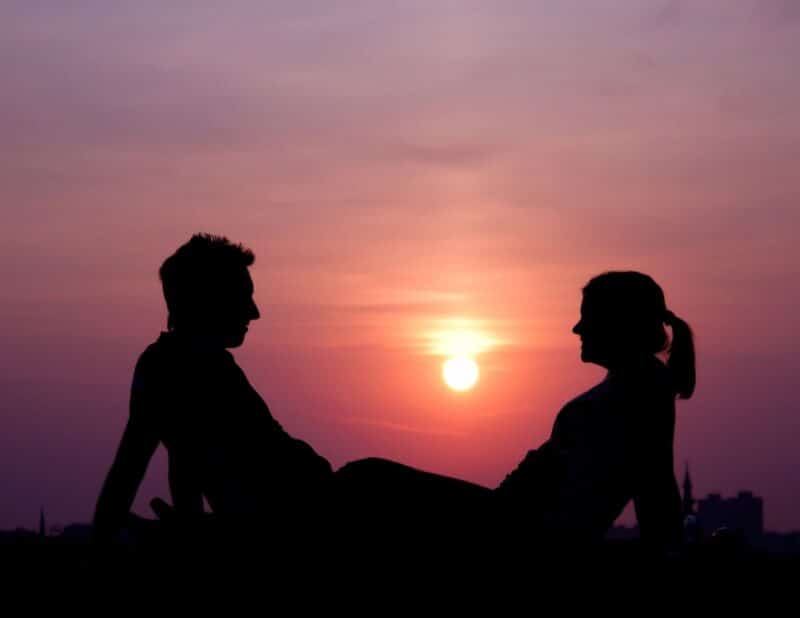 couple laying in sunset