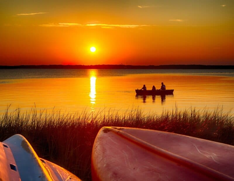 sunset couple in boat