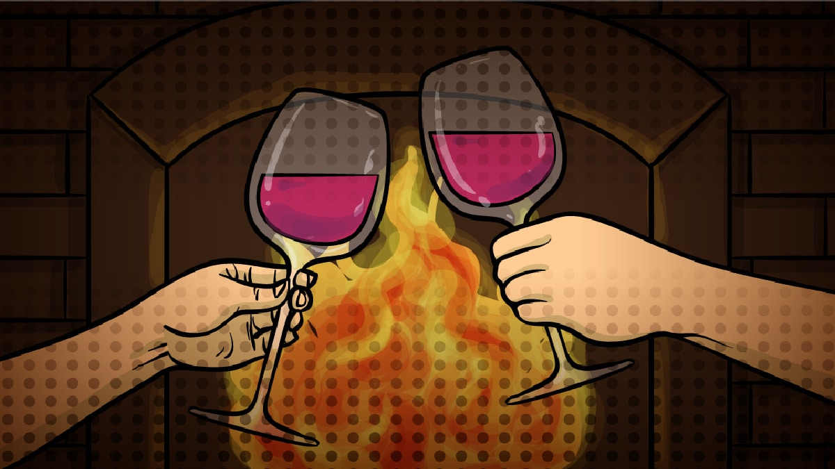 romantic staycation ideas pari of wine glasses in front of romantic fire