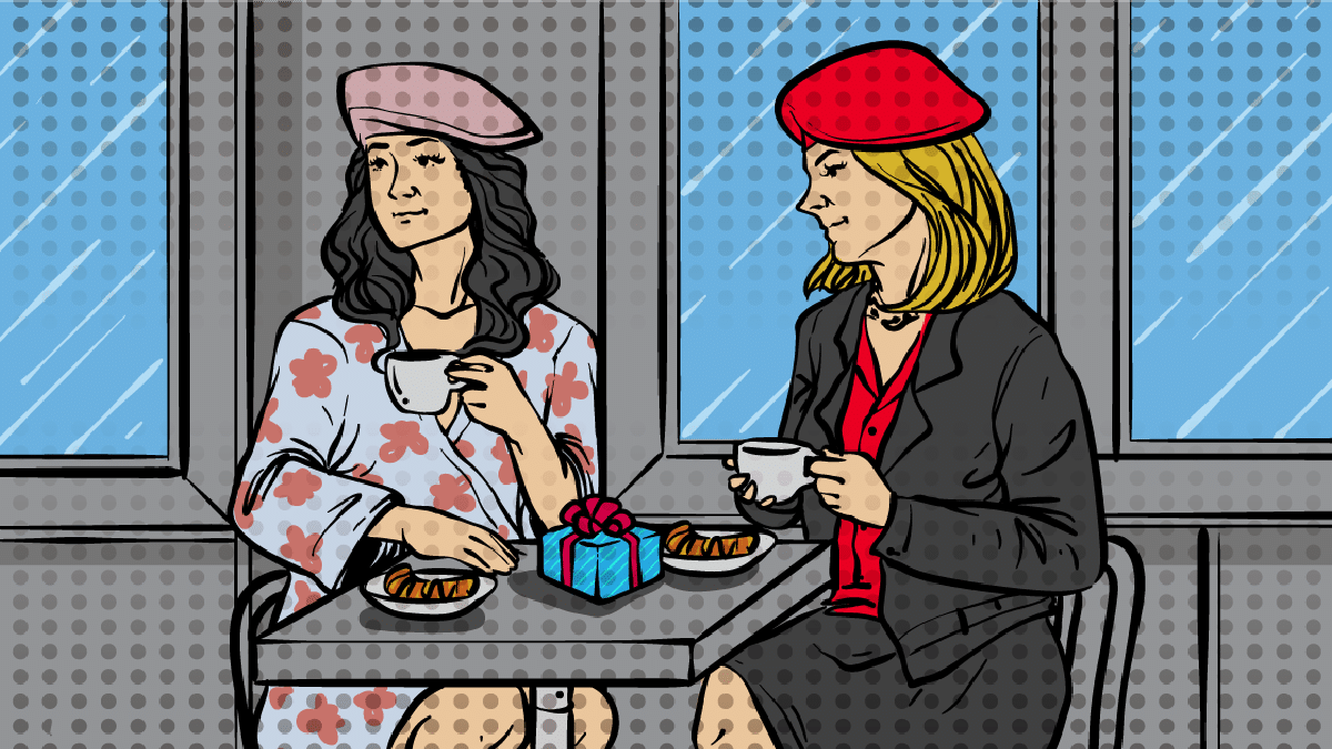 Paris-Themed-Gifts-cartoon of two girls at a French cafe with a gift.png