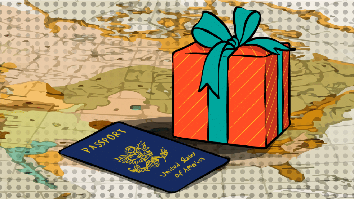 gifts-for-friends-going-abroad- passport and gift sitting on top of map1.png